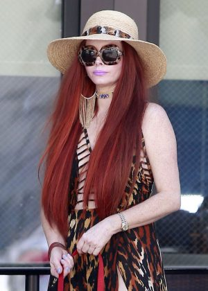 Phoebe Price walking her dog in Beverly Hills
