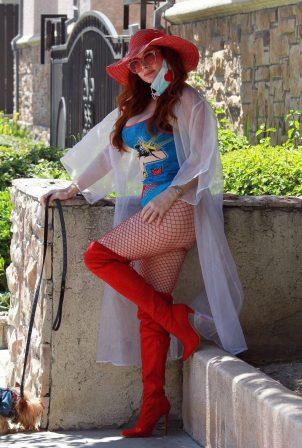 Phoebe Price - Wearing Wonder Woman mini dress in Los Angeles