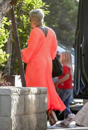 Pink - In a flowing bright orange dress in Malibu