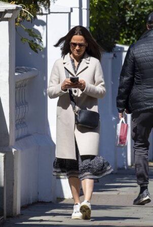 Pippa Middleton - In a cream coat and white trainers as she heads out in London