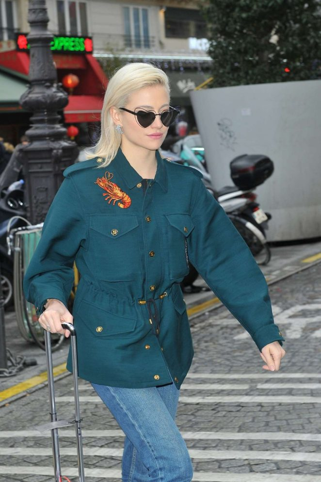 Pixie Lott - Arrives back to London