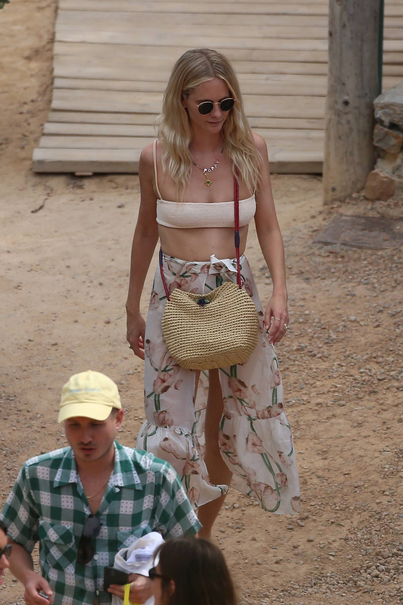 Poppy Delevingne - With friend Jack Guinness at restaurante Es Toerrent in Ibiza