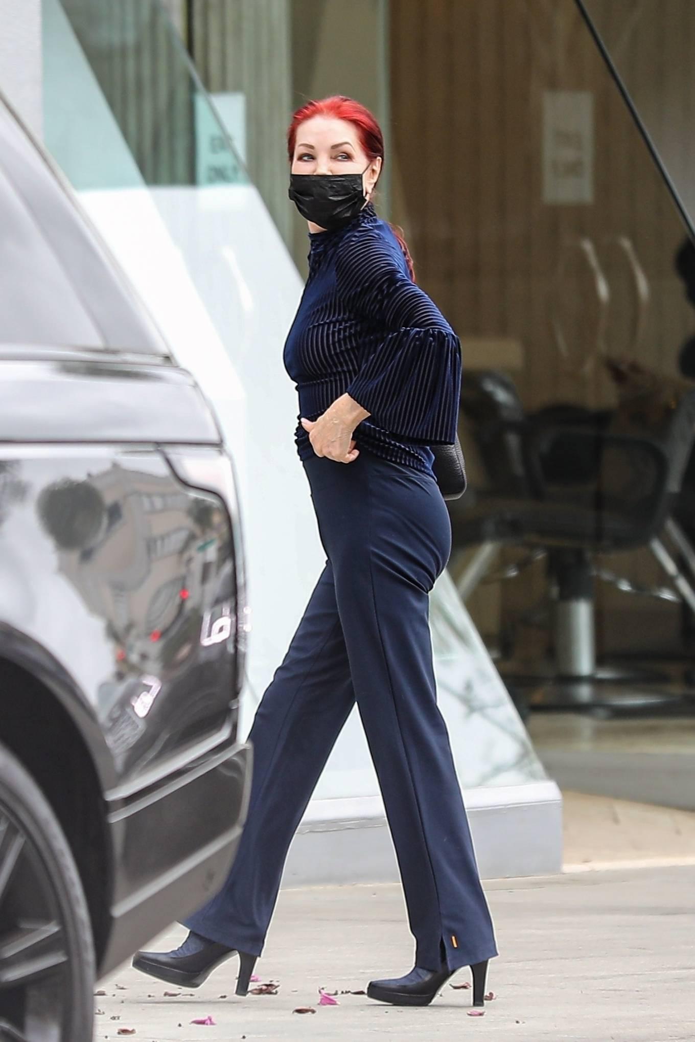 Priscilla Presley - Wears dark blue in Beverly Hills