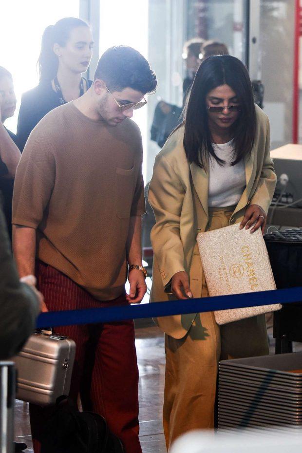 Priyanka Chopra and Nick Jonas - Leaves from Nice Airport in France