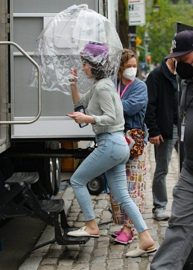 Rachel Brosnahan - AWith her HEPA filter clear umbrella in New York