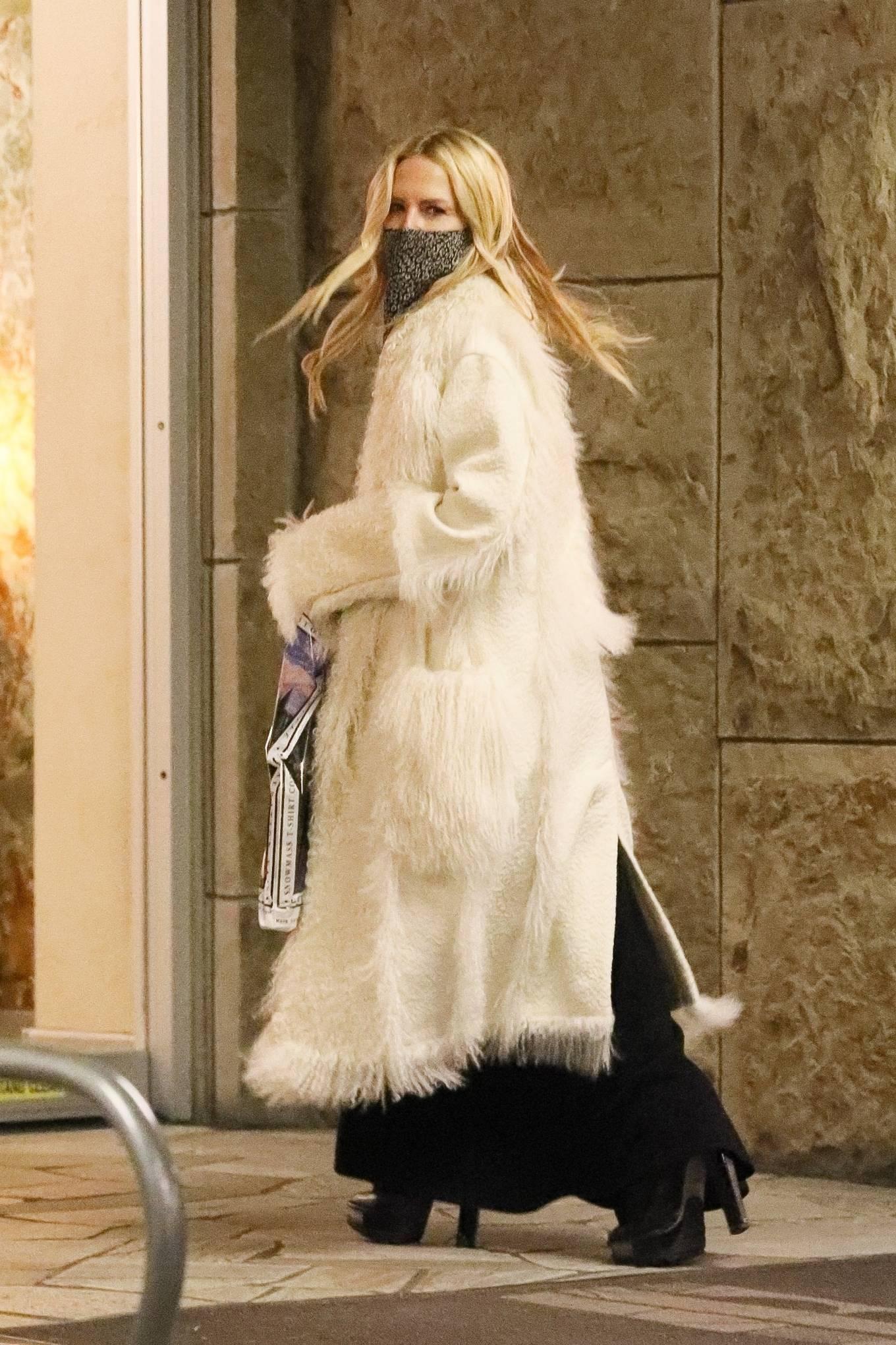Rachel Zoe - In a long white coat with her son in Aspen