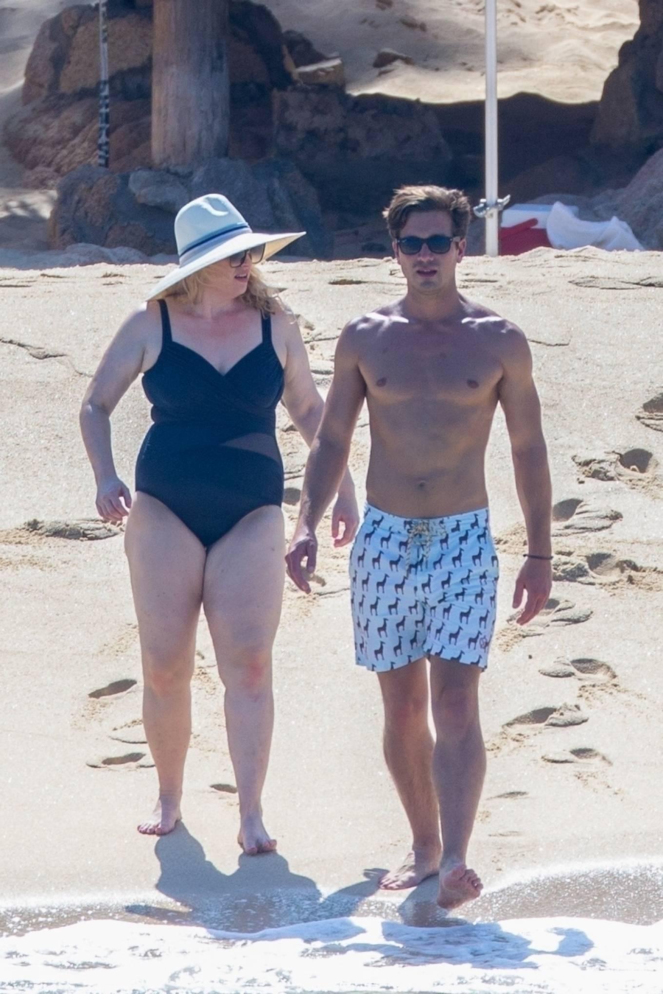 Rebel Wilson in black swimsuit with boyfriend Jacob Busch in Cabo San Lucas