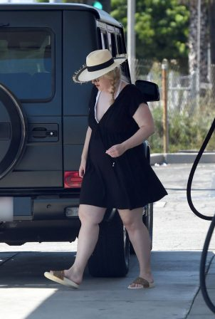Rebel Wilson - Seen pumping gas in Malibu