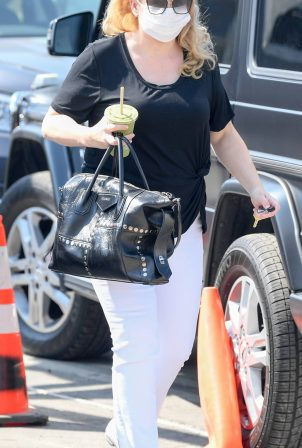 Rebel Wilson - Visits an office building in Los Angeles