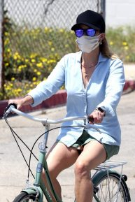 Reese Witherspoon - In denim shorts riding a bike in Malibu