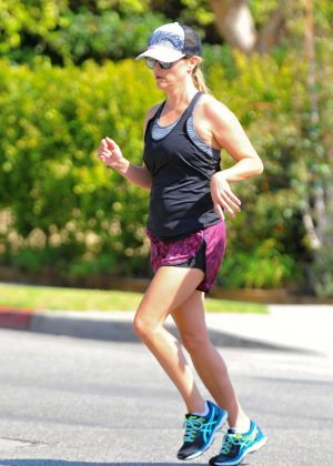 Reese Witherspoon in shorts jogging in Los Angeles
