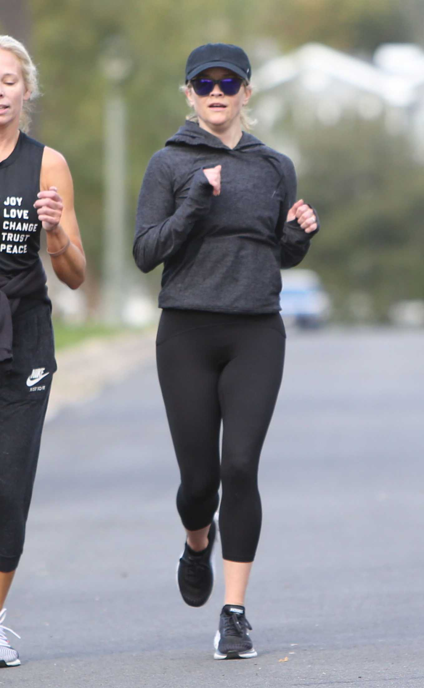 Reese Witherspoon - Jogging candids with a friend in Los Angeles