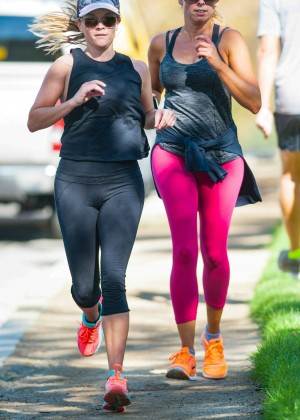 Reese Witherspoon - Jogging with a friend in Los Angeles