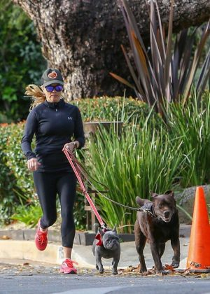Reese Witherspoon - Out for a jog with her two dogs in Santa Monica