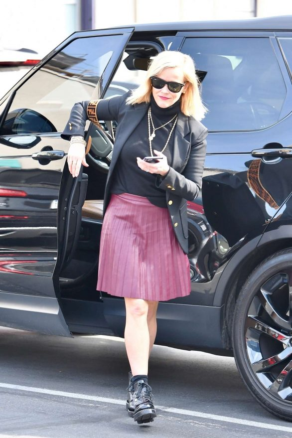 Reese Witherspoon 2019 : Reese Witherspoon – Wears a pleated purple skirt at her office with her bulldog-05