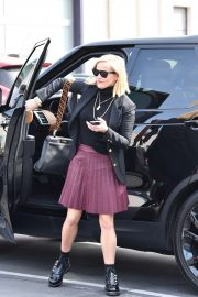 Reese Witherspoon - Wears a pleated purple skirt at her office with her bulldog
