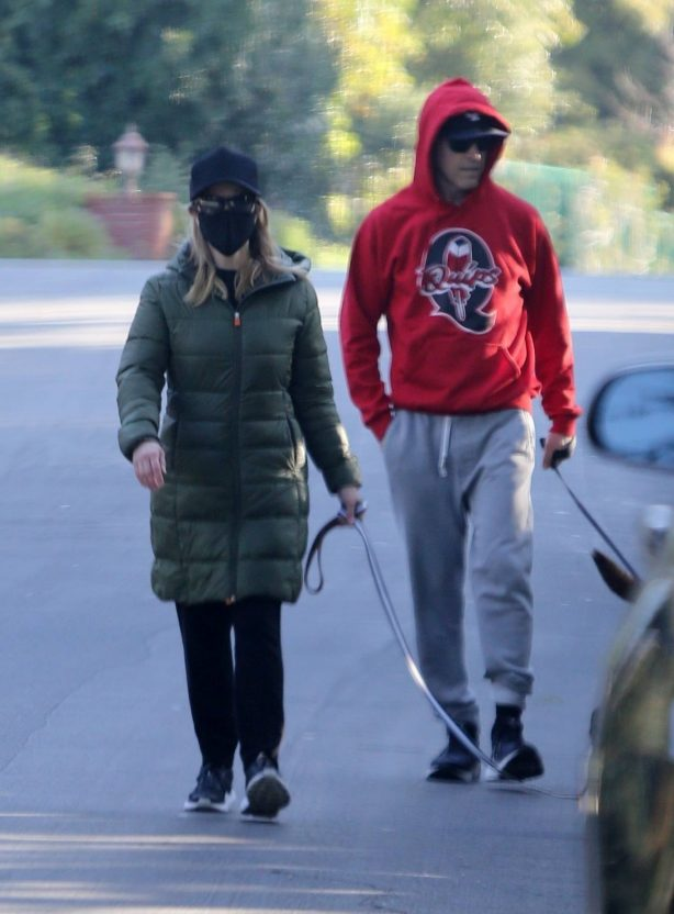 Reese Witherspoon - With her husband Jim Toth on Superbowl Sunday in Brentwood