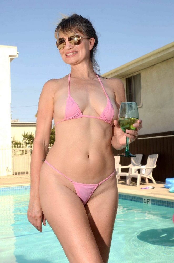 Rena Riffel in Pink Bikini on the pool in Beverly Hills