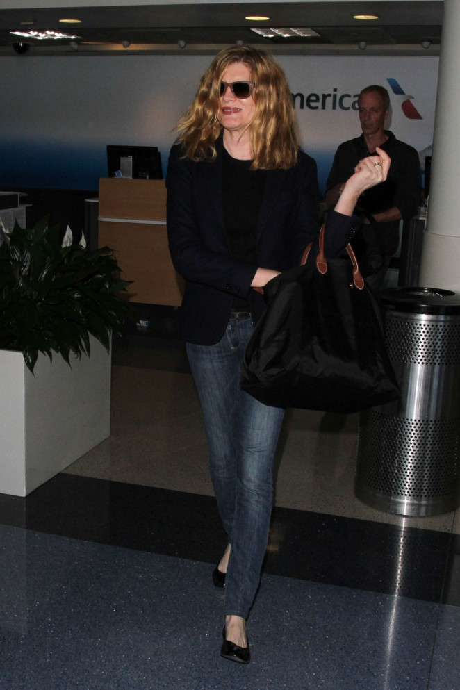 Rene Russo in Jeans at LAX Airport in LA
