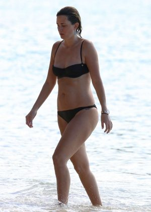 Rhea Durham in Black Bikini on the beach in Barbados