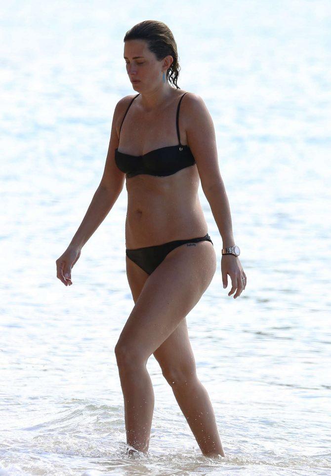 Rhea Durham in Black Bikini on the beach in Barbados