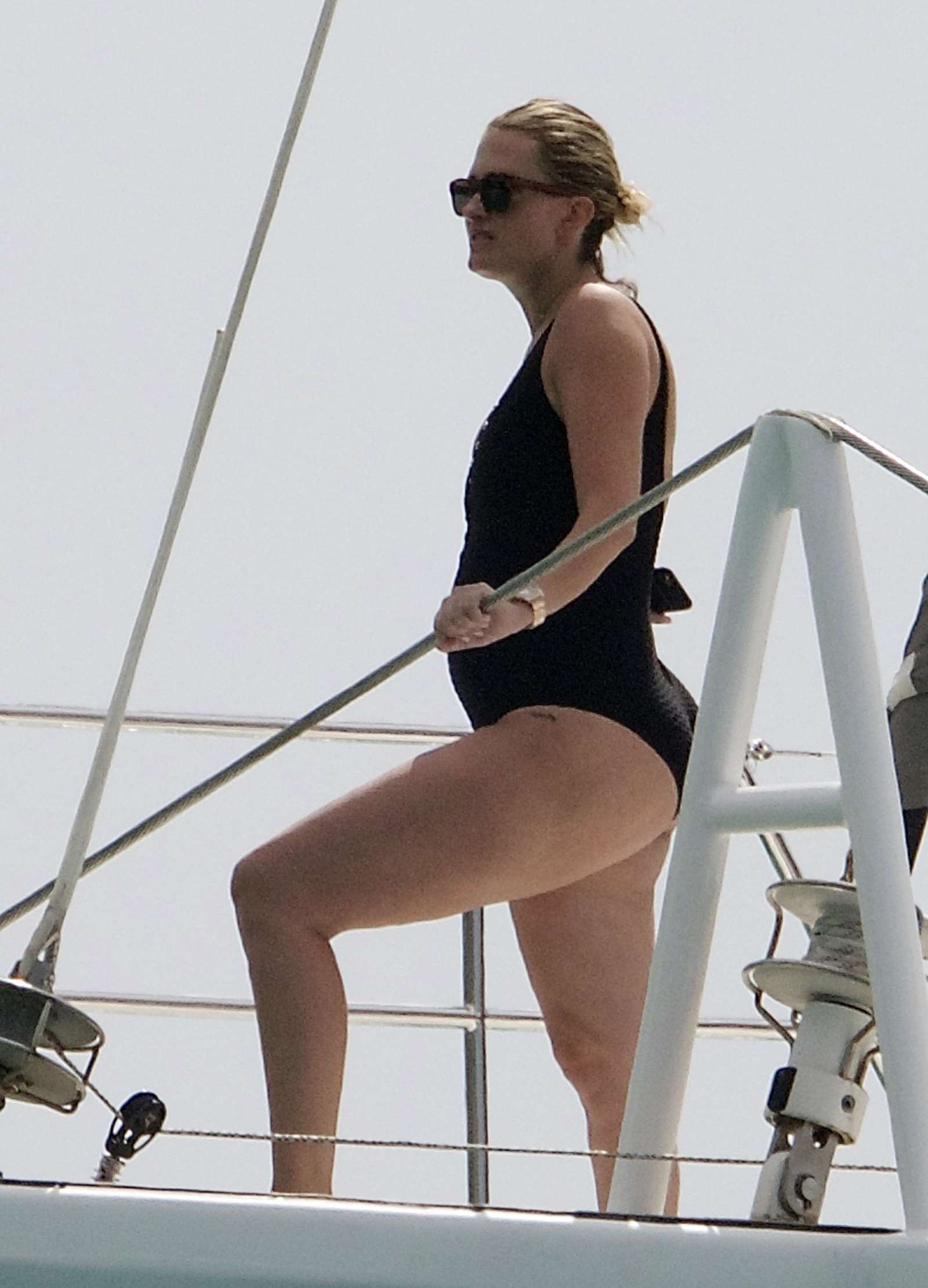 Rhea Durham in Black Swimsuit on a yacht in Barbados