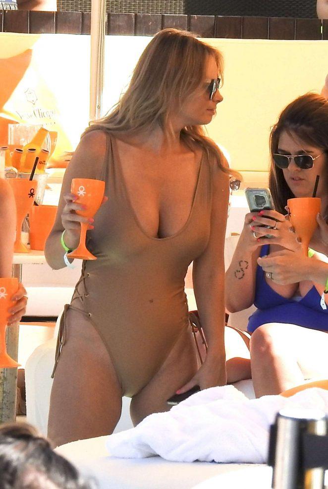 Rhian Sugden – In gold tight swimsuit at Ibizas Ocean Beach Club