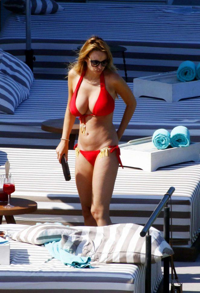Rhian Sugden in Red Bikini at a pool in Ibiza