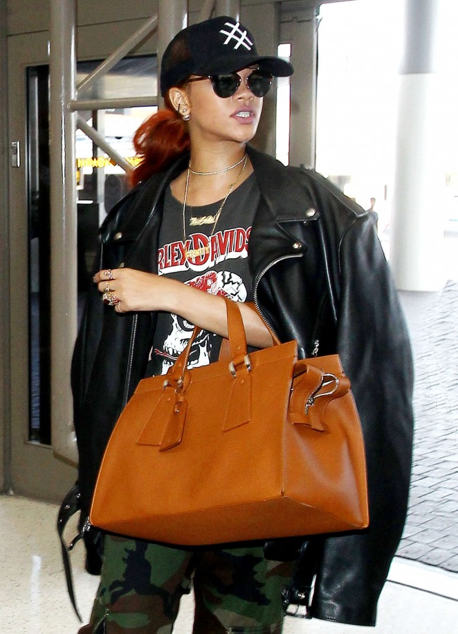 Rihanna in Leather Jacket at LAX airport in LA