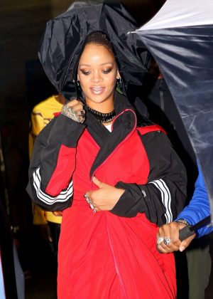 Rihanna in black and red coat out in the East Village