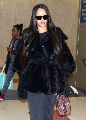 Rihanna in Fur Coat - Arrives at JFK Airport in NYC