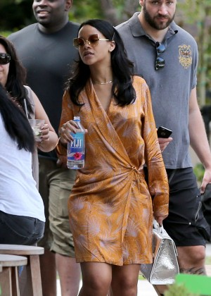 Rihanna in Mini Dress at a poolside bar in Miami