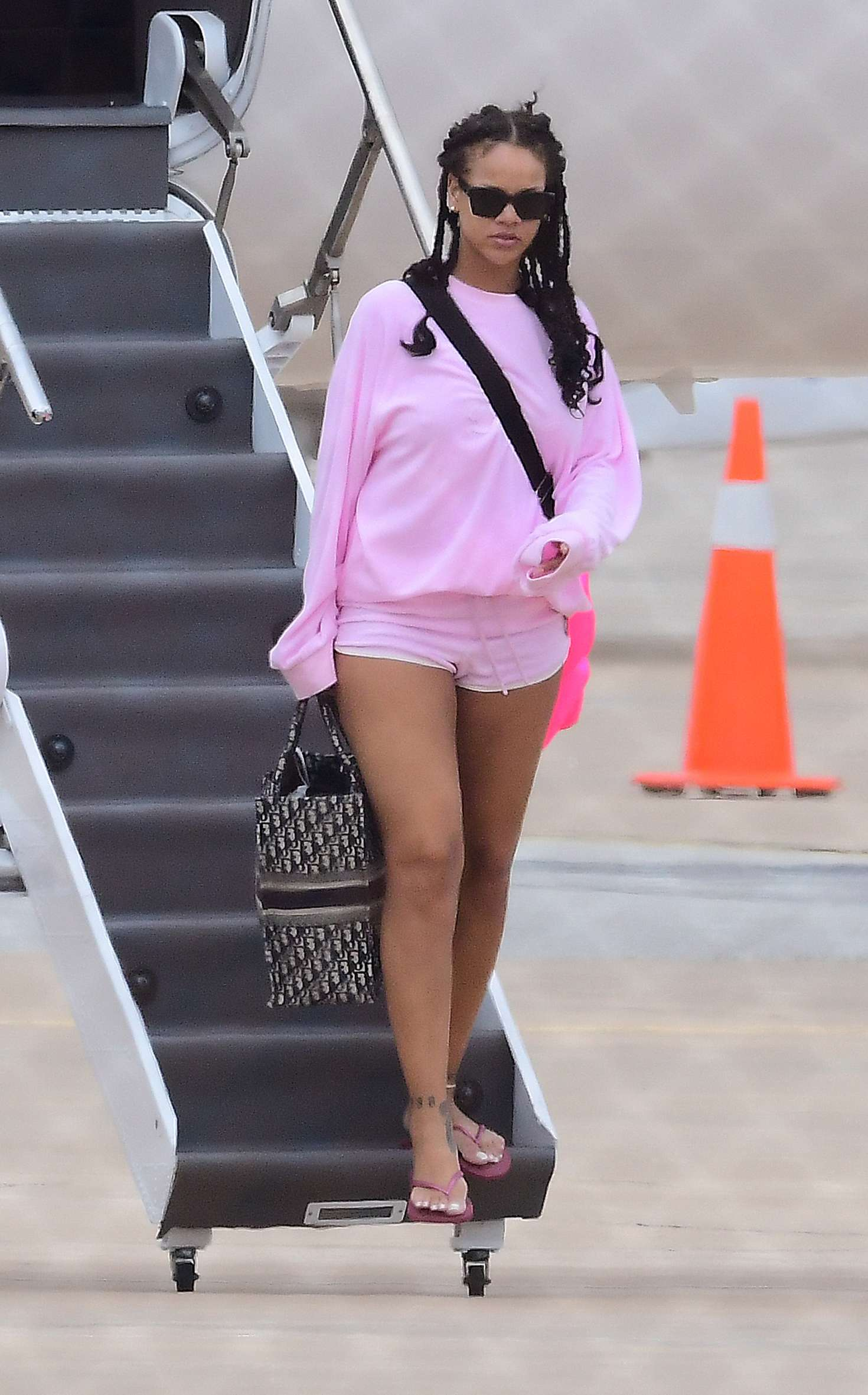 Rihanna in Pink Shorts – Arrives at Airport in Barbados