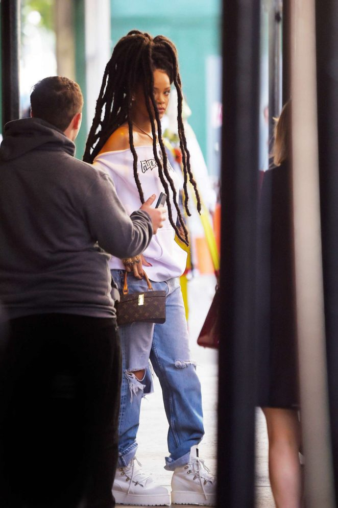 Rihanna in Ripped Jeans in NYC -04