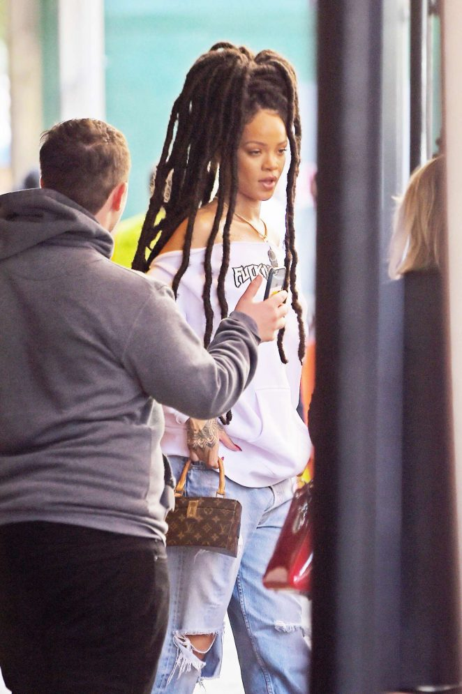 Rihanna in Ripped Jeans in NYC -10