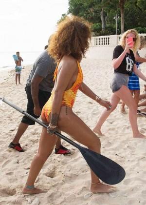 Rihanna in Orange Swimsuit -01