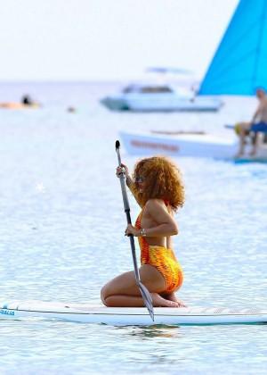 Rihanna in Orange Swimsuit -37