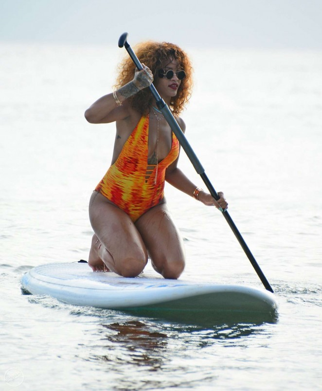 Rihanna in Orange Swimsuit Paddleboarding in Barbados