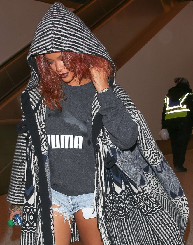 Rihanna in Jeans Shorts at LAX airport in LA