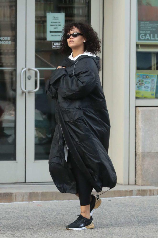 Rihanna wears a black maxi coat in New York