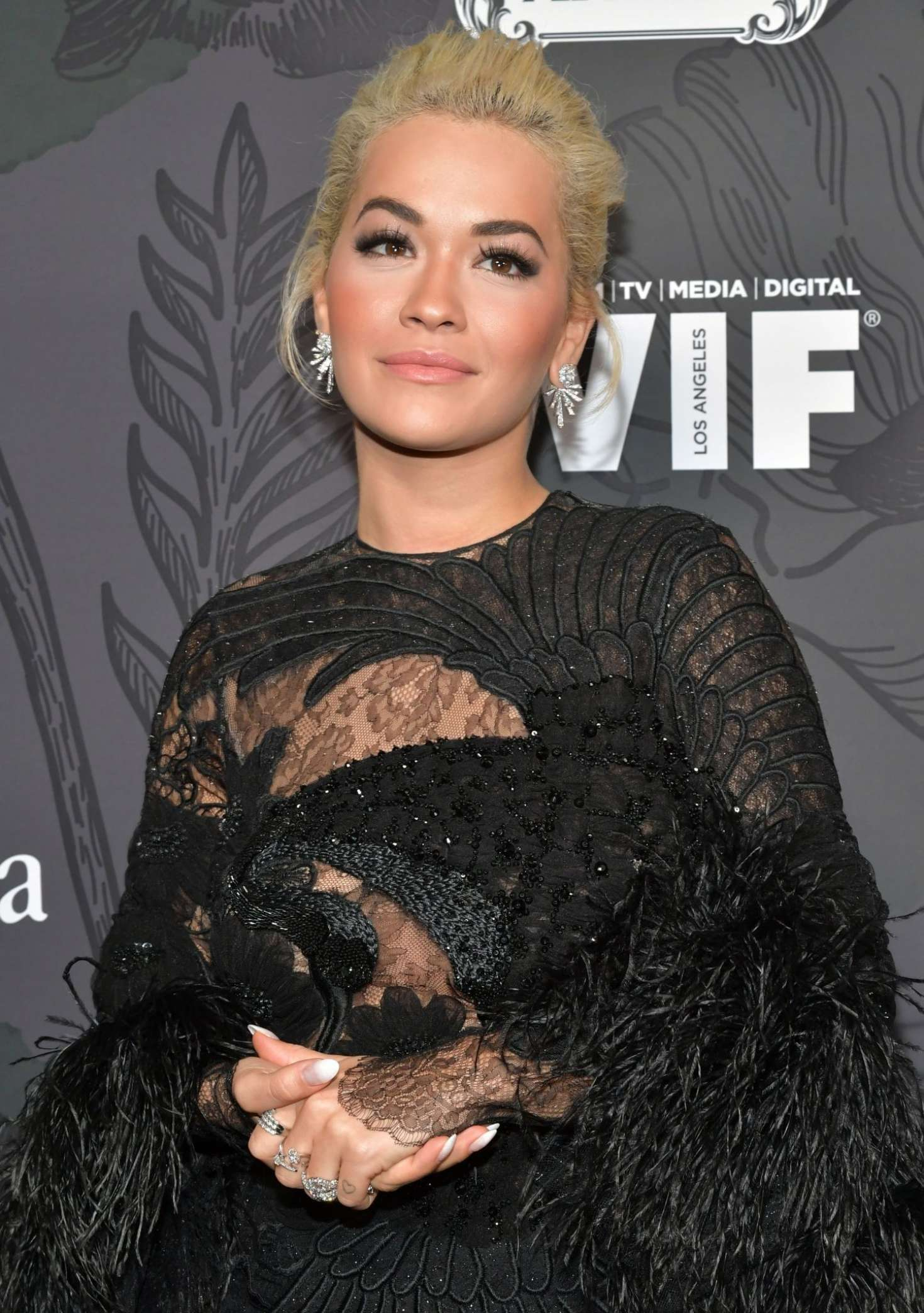 https://www.gotceleb.com/wp-content/uploads/photos/rita-ora/2019-women-in-film-oscar-party-in-beverly-hills/Rita-Ora:-2019-Women-In-Film-Oscar-Party--04.jpg