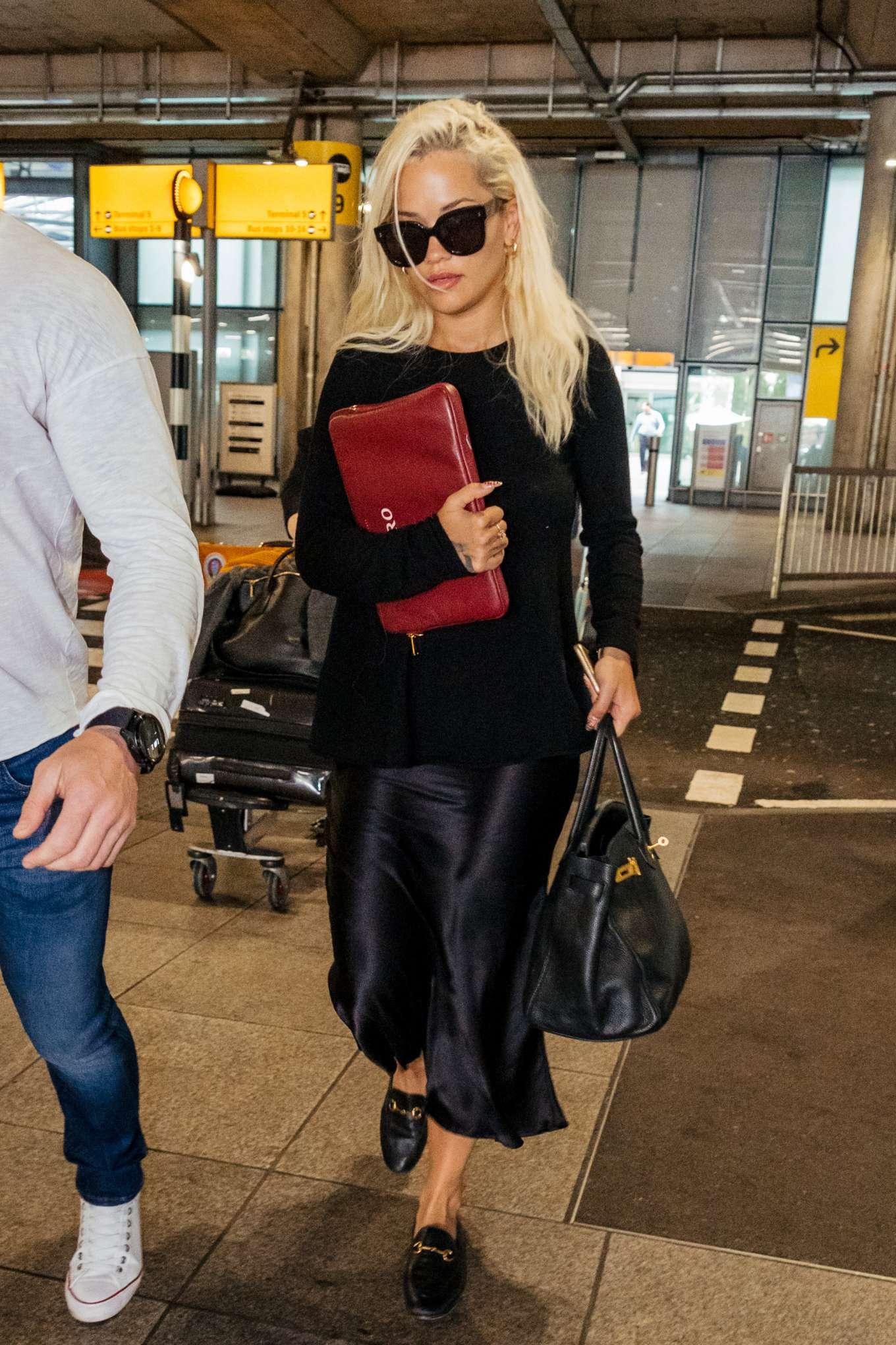 Rita Ora - Arrives at Heathrow Airport in London