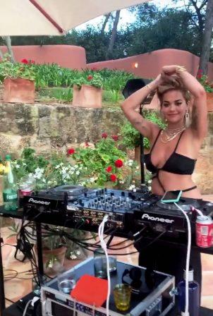 Rita Ora - In a bikini top at a birthday party in Ibiza