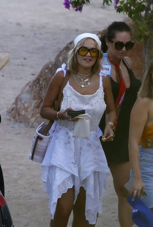 Rita Ora - In a white dress out for dinner in Ibiza