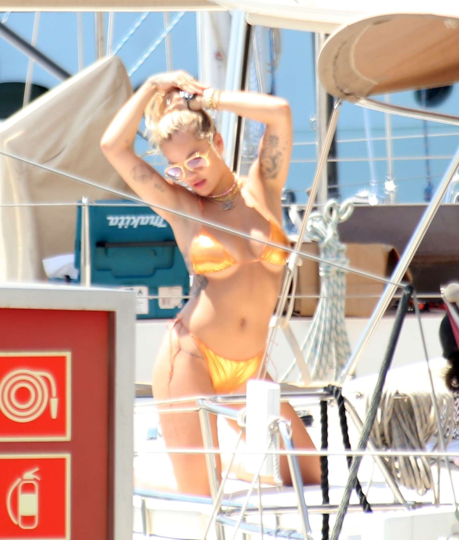 Rita Ora in Gold Bikini on a yacht  in Barcelona