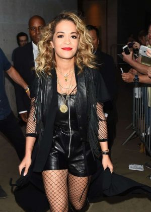 Rita Ora in Leather Playsuit Arrives in Glastonbury