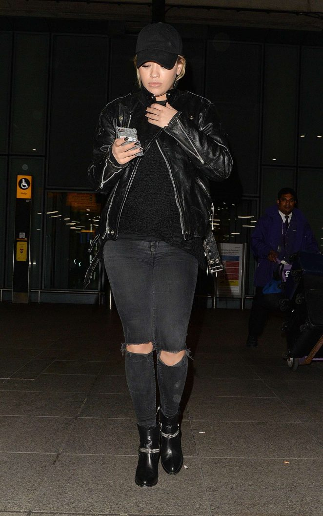 Rita Ora in Ripped Jeans at Heathrow airport in London