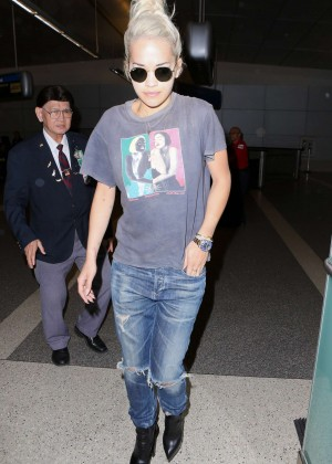 Rita Ora in Ripped Jeans at LAX Airport in LA