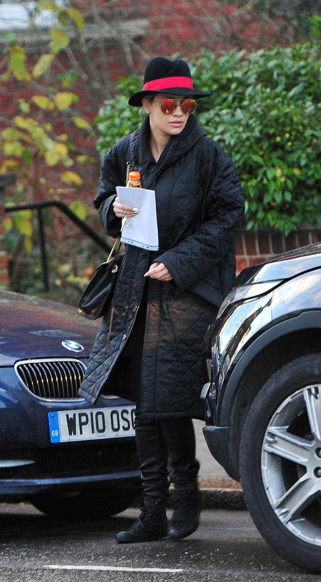 Rita Ora in Long Black Coat Leaving her home in London