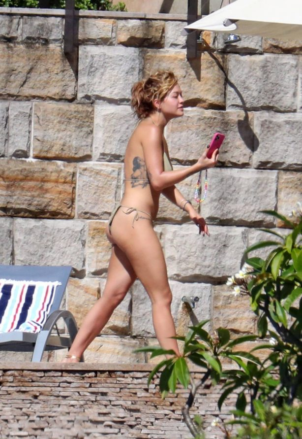 Rita Ora - Poolside candids wearing a green bikini in Sydney
